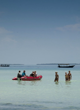 Zanzibar-Wading-in-Sea © Marion Whitehead